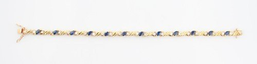 7: An 18 Karat Yellow Gold, Blue Sapphire and Diamond B