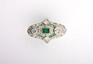 12: A Platinum, Diamond and Emerald Ring,