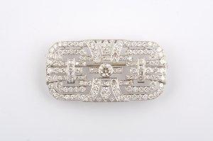 19: A Platinum and Diamond Art Deco Brooch,
