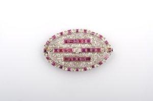 20: A Platinum, Diamond and Ruby Brooch,