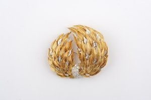 196: A Yellow and White Gold and Diamond Brooch,