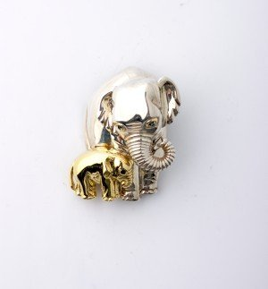 287: An 18 Karat Yellow Gold and Sterling Silver Pin, T