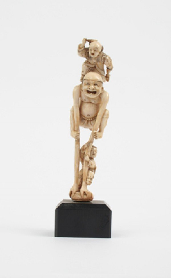 390: A Japanese Carved Ivory Figural Group, Height 6 in