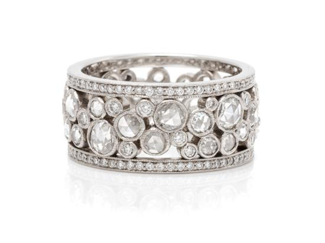 * A Platinum and Diamond 'Cobblestone' Eternity Band,