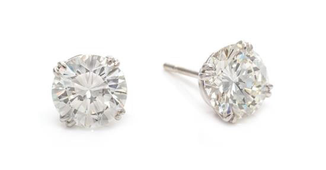 A Pair of Platinum and Diamond Stud Earrings, 1.90