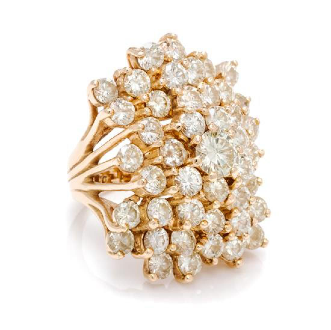 A 14 Karat Yellow Gold and Diamond Cluster Ring, 13.60