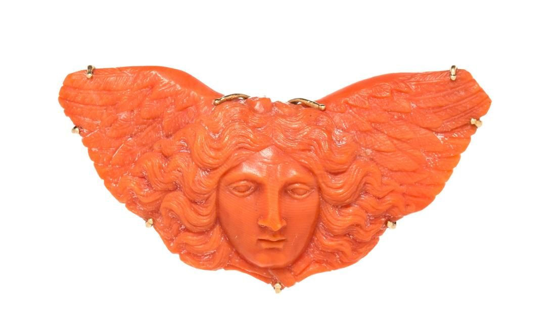 A Victorian Rose Gold and Carved Coral Angel Brooch,