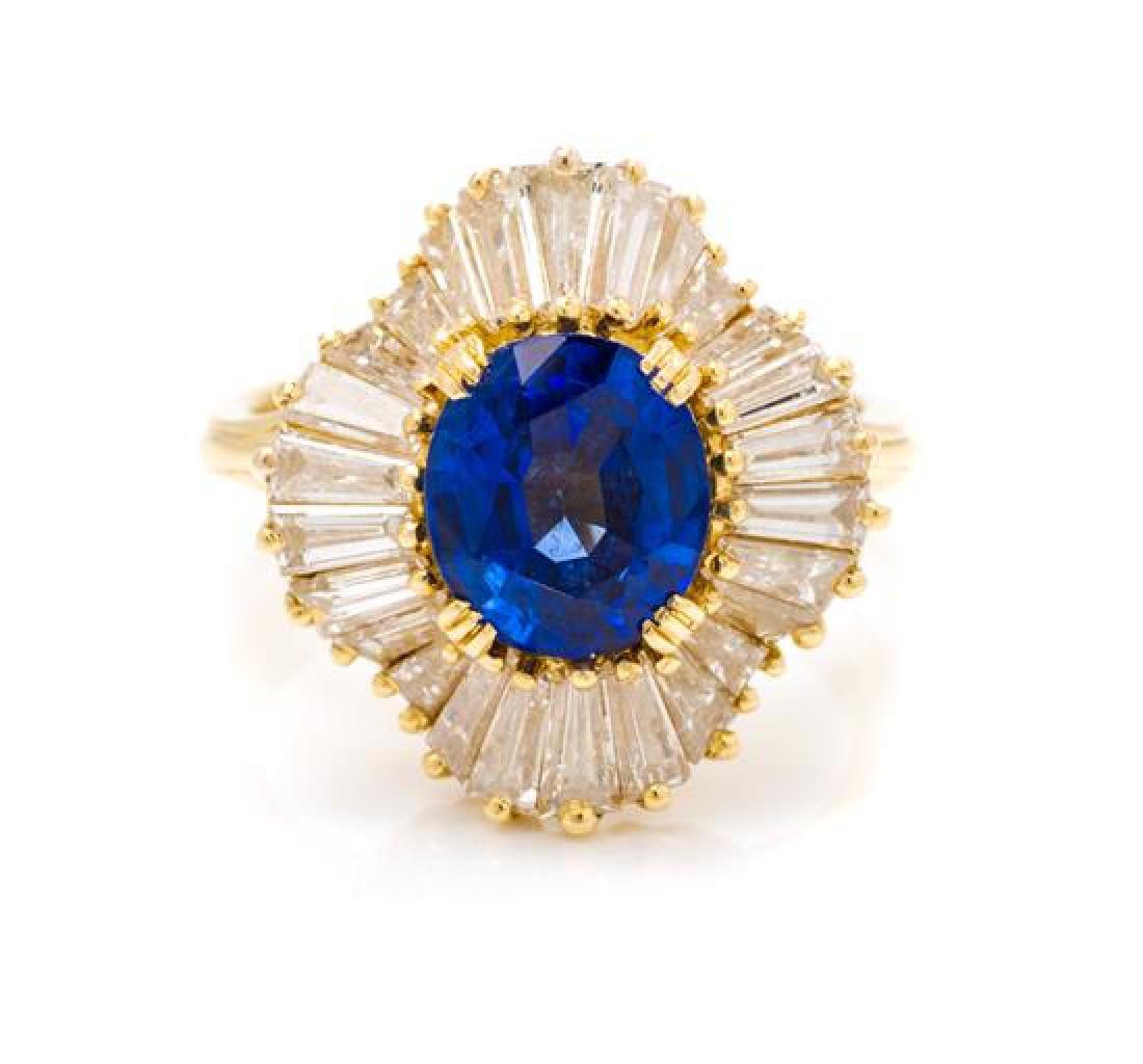 * An 18 Karat Yellow Gold, Sapphire and Diamond