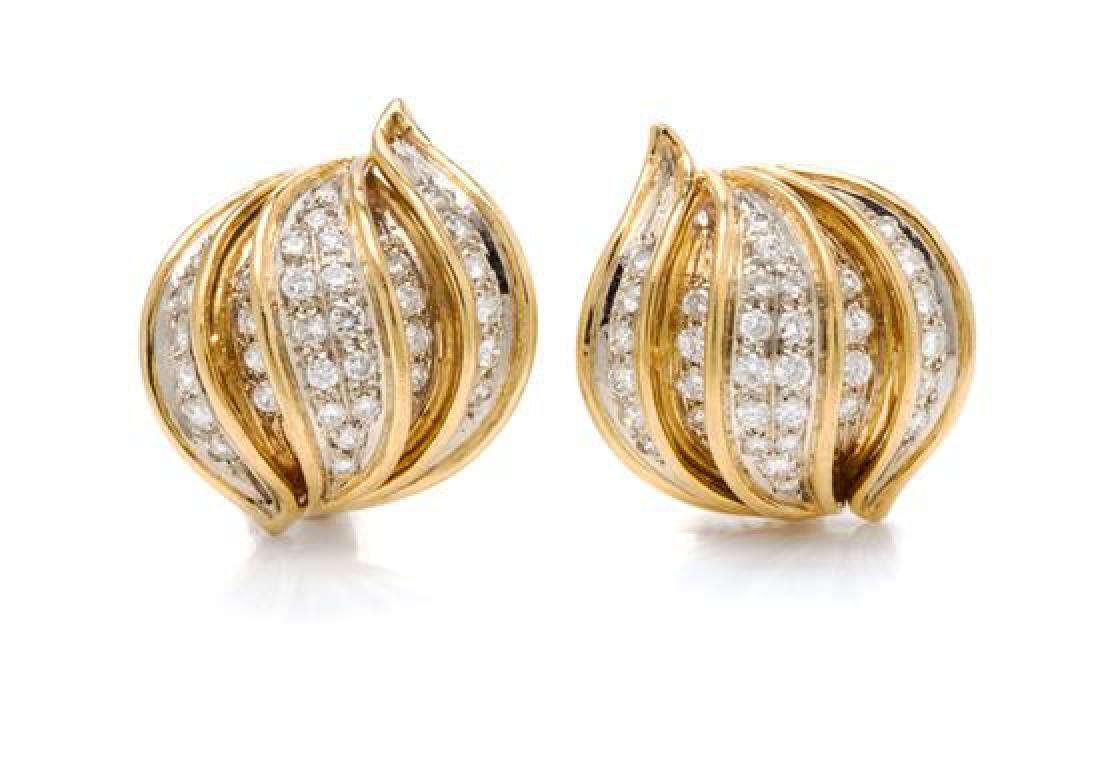 A Pair of Bicolor Gold and Diamond Earclips, 15.95
