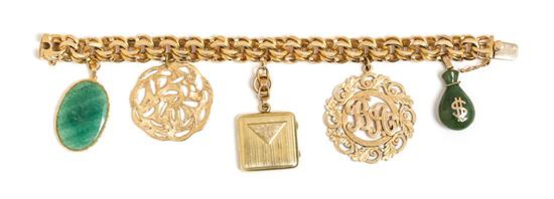 * A 14 Karat Yellow Gold Bracelet with Five Attached