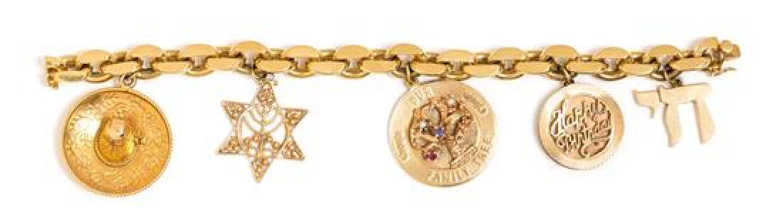 * An 18 Karat Yellow Gold Bracelet with Five Attached