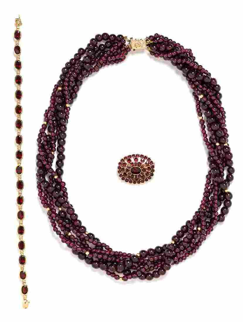 * A Collection of 14 Karat Yellow Gold and Garnet