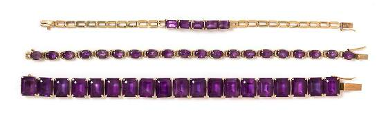 * A Collection of 14 Karat Gold and Amethyst Bracelets,