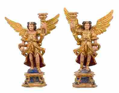 A Pair of Italian Painted and Gilt Figural Candlesticks