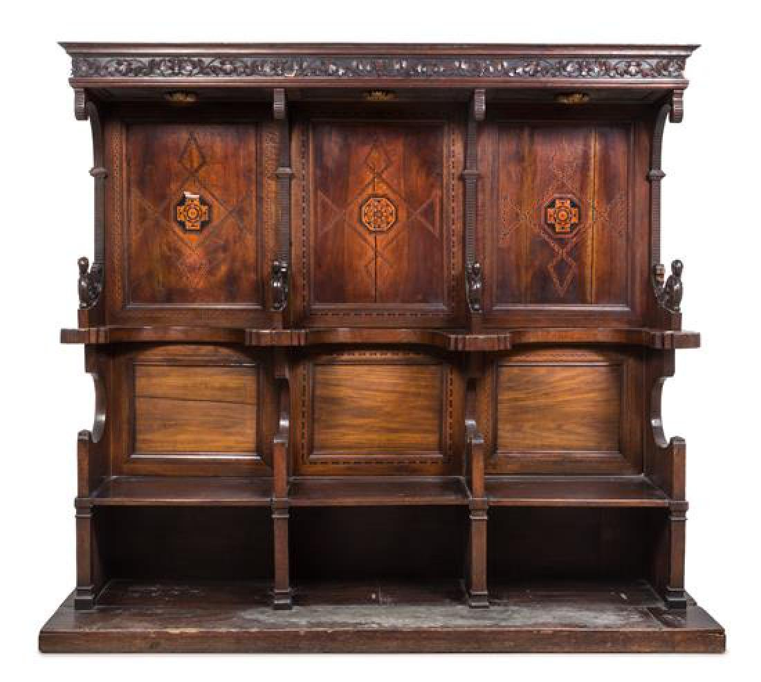 An Italian Walnut Choir Stall