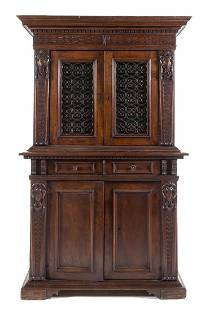 An Italian Renaissance Style Walnut Cabinet