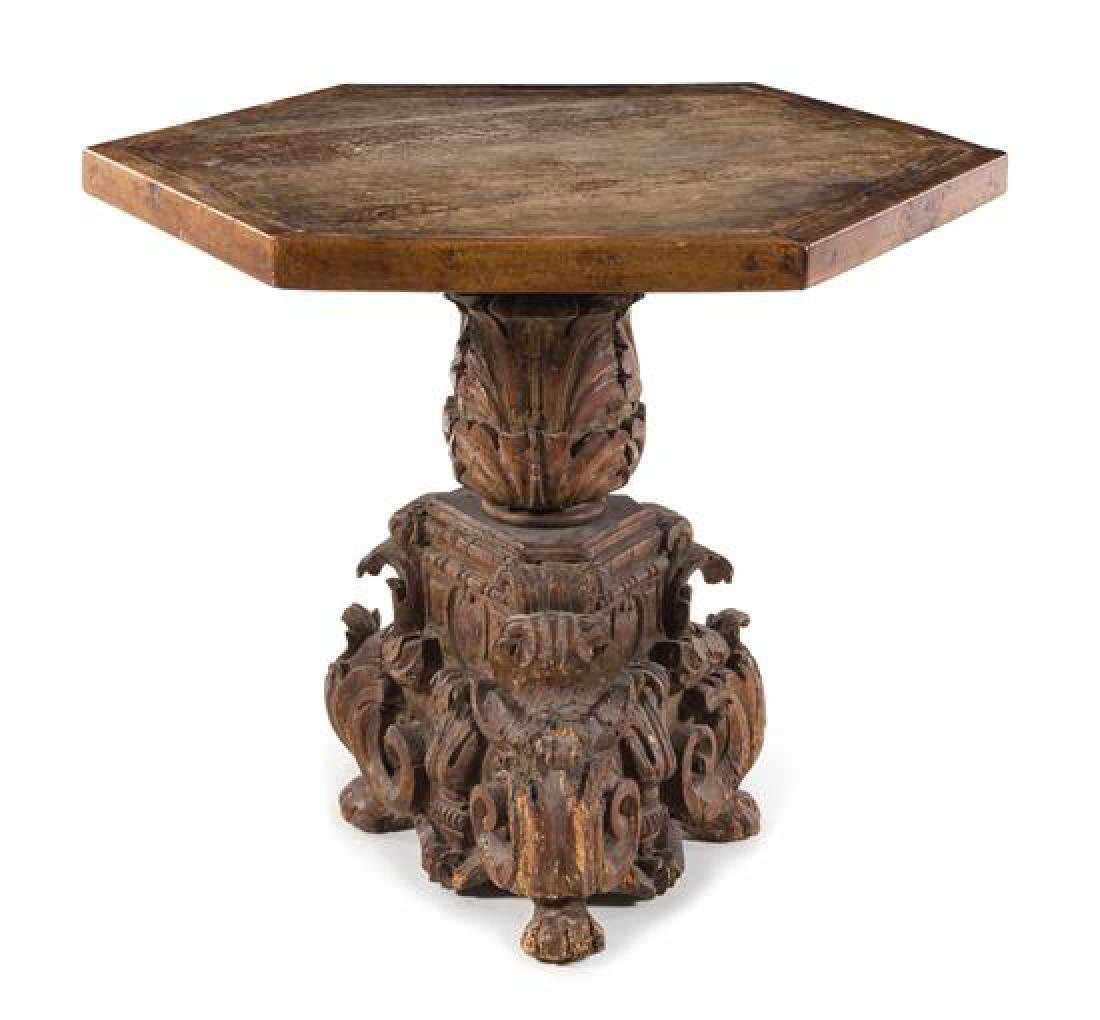 An Italian Baroque Carved Walnut Center Table