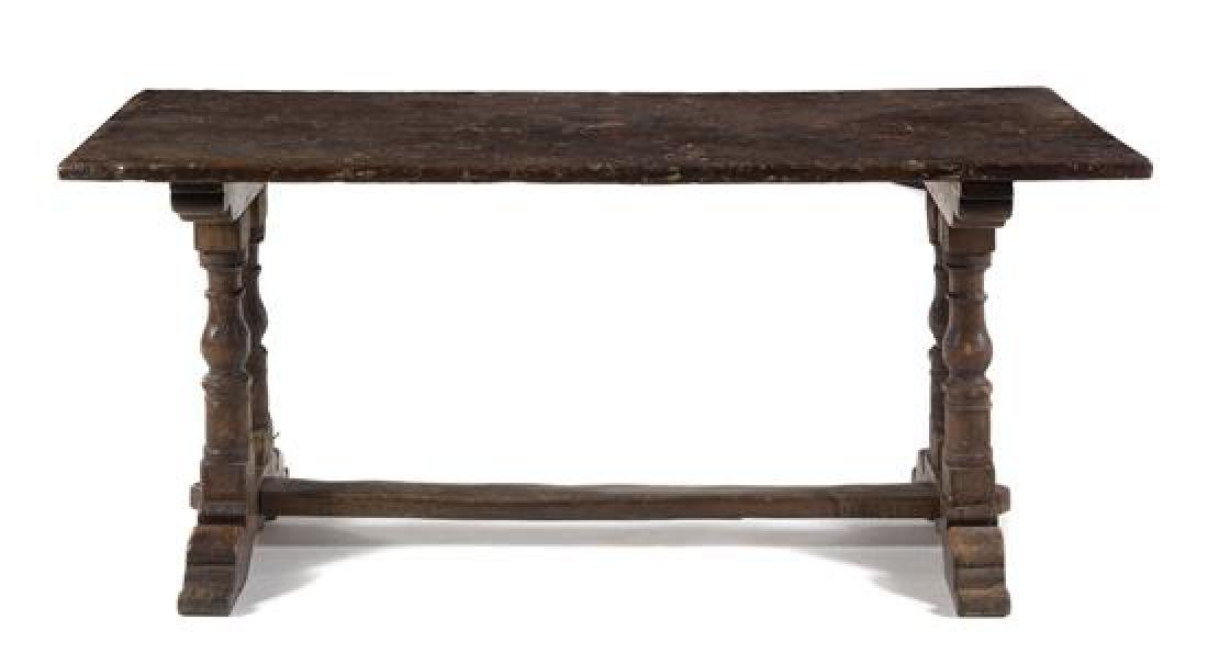 An Italian Walnut Refectory Table