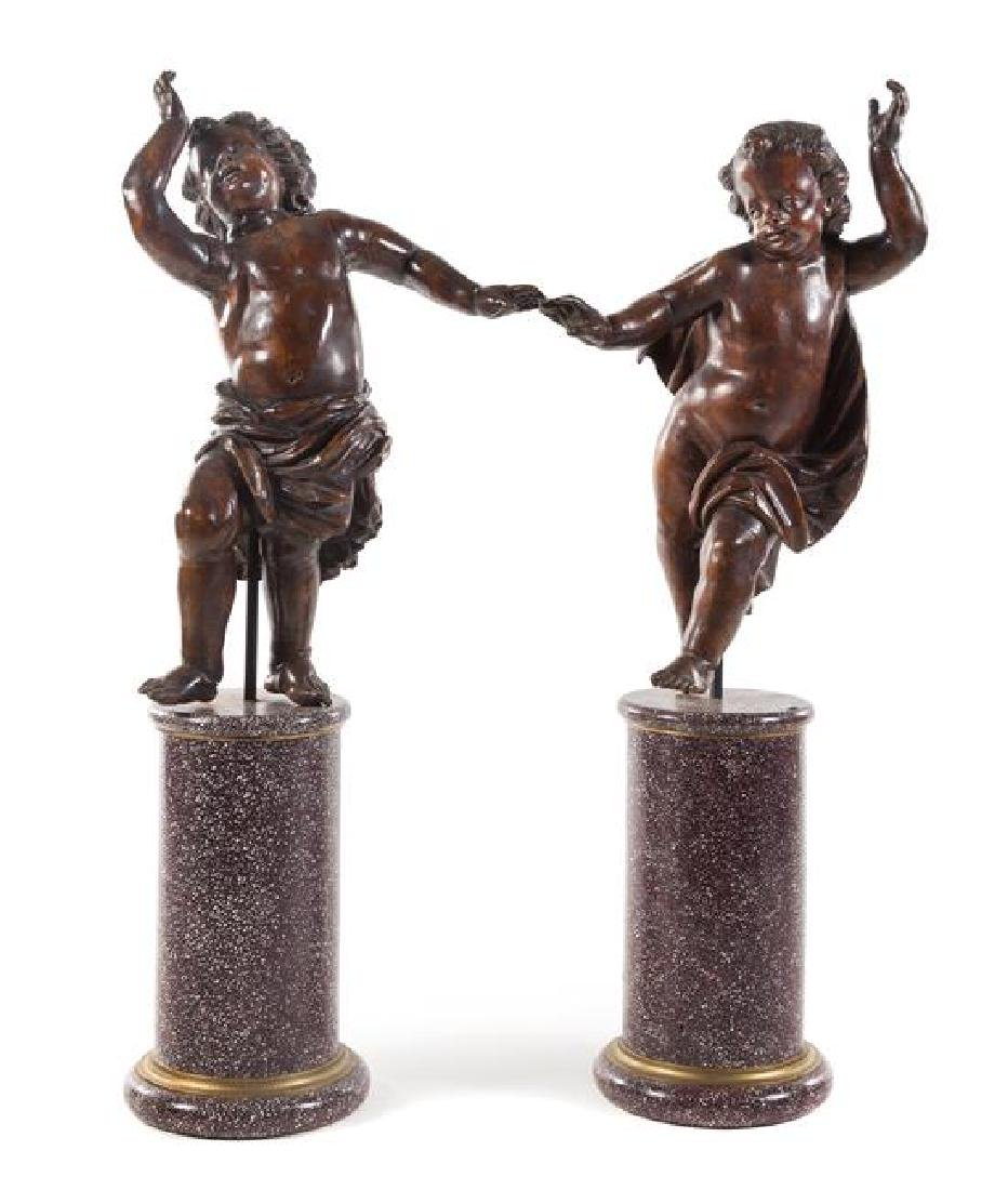 A Pair of Italian Carved Oak Figures