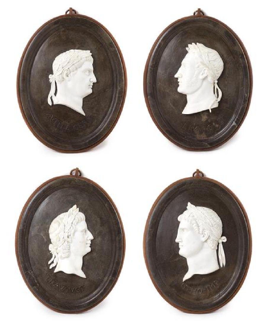 A Set of Four Marble Profile Plaques