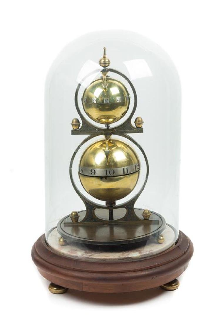 A Gustave Jeager Double Globe Patent Clock