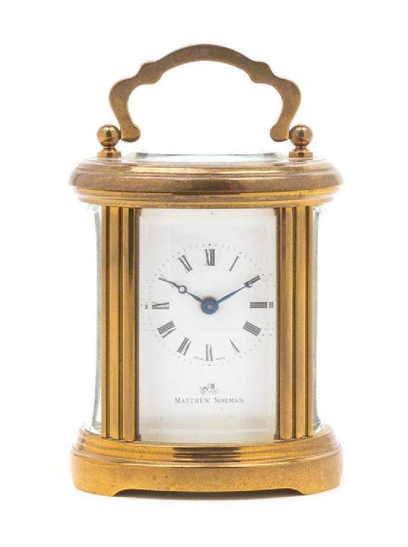 A Swiss Gilt Brass Carriage Clock