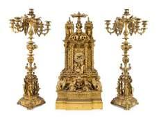 A French Gothic Revival Gilt Bronze Clock Garniture