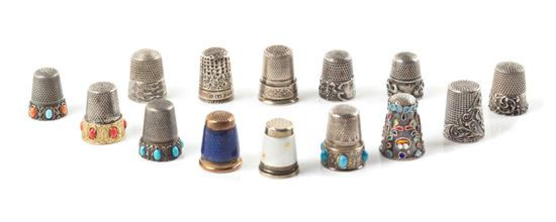 A Group of Fourteen Silver Thimbles