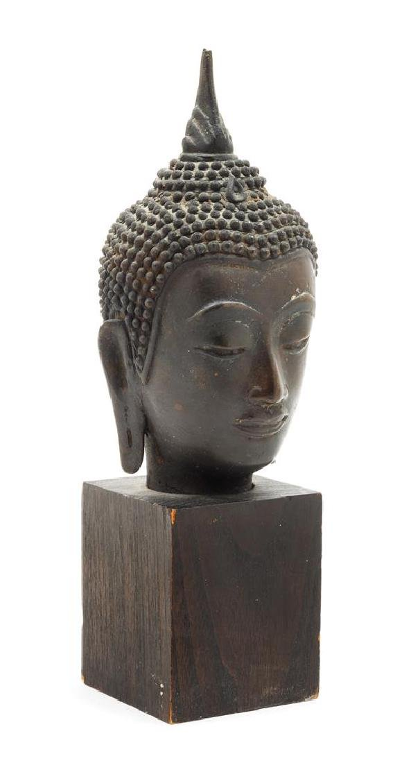 A Cambodian Bronze Head of Buddha