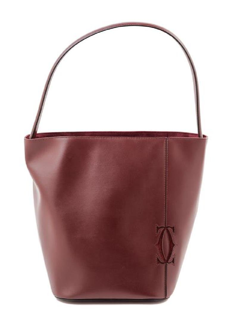 A Cartier Burgundy Calfskin Must-C Bucket Bag,