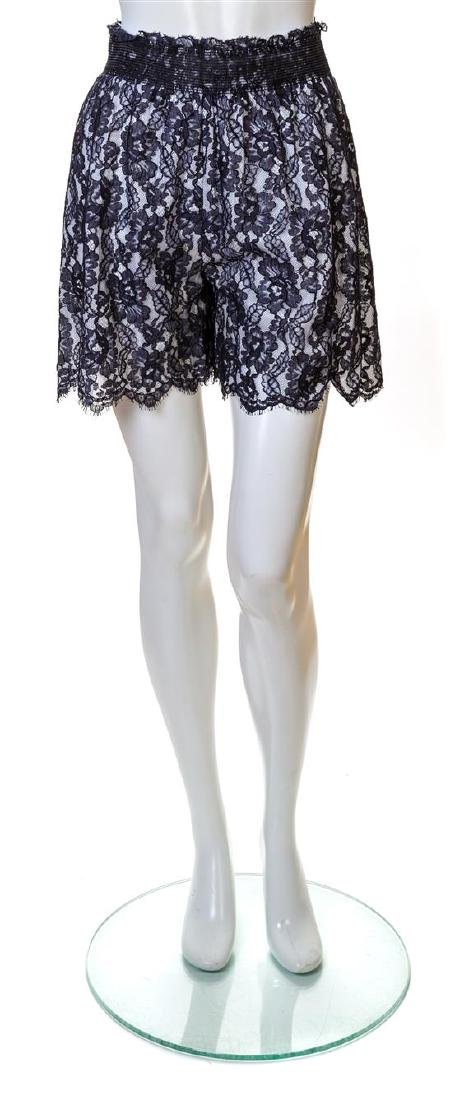 A Pair of Chanel Navy Lace Shorts,