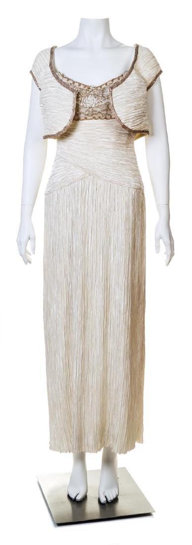 A Mary McFadden Cream Silk Pleated Gown with Bolero,
