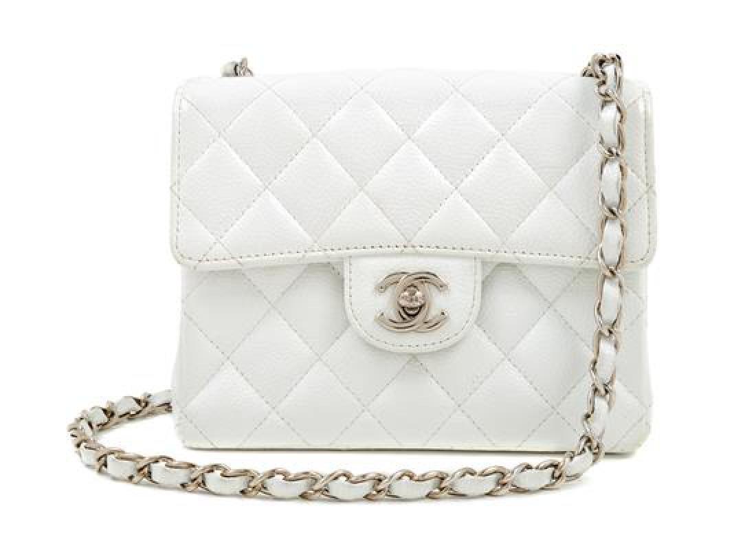 A Chanel White Caviar Mini Cross Body Flap Bag,