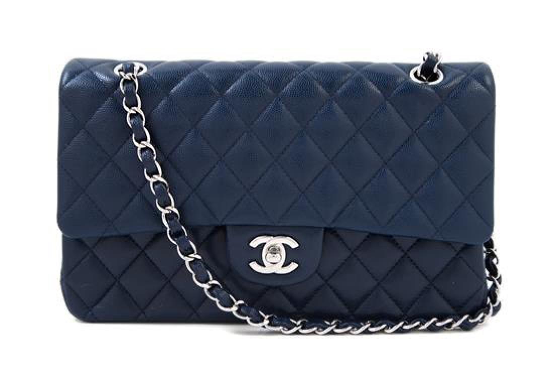 A Chanel Navy Caviar Classic Double Flap Handbag,