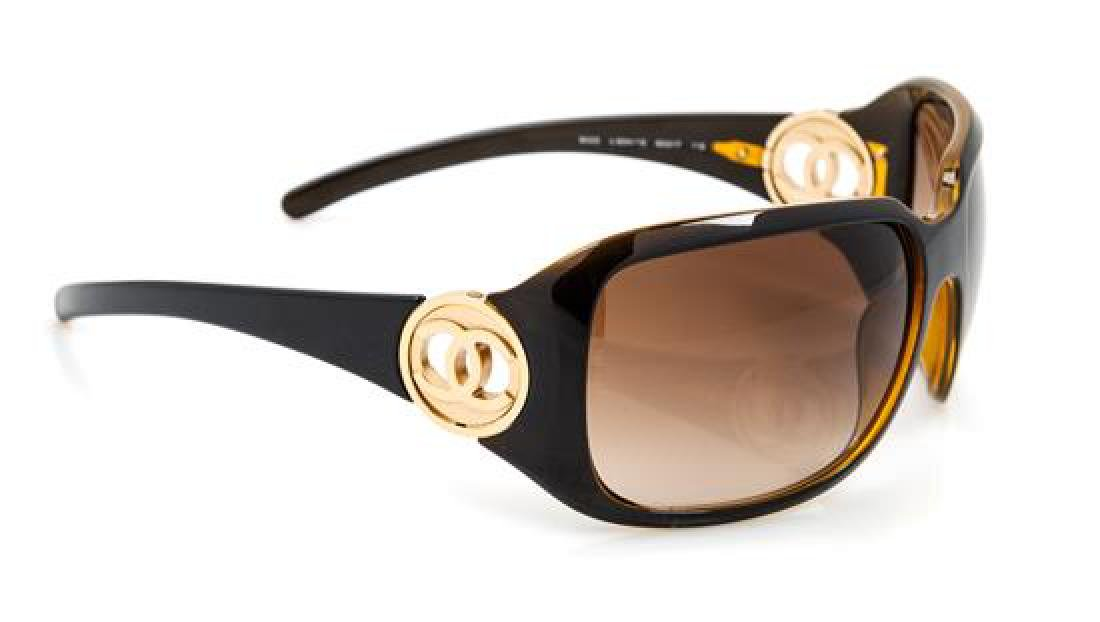 A Pair of Chanel Brown Frame Sunglasses,
