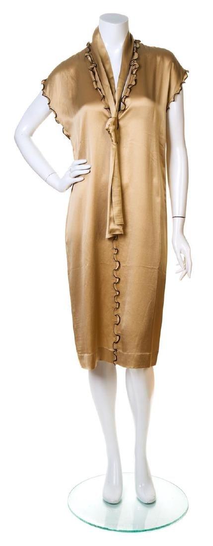 An Yves Saint Laurent Champagne Silk Dress,