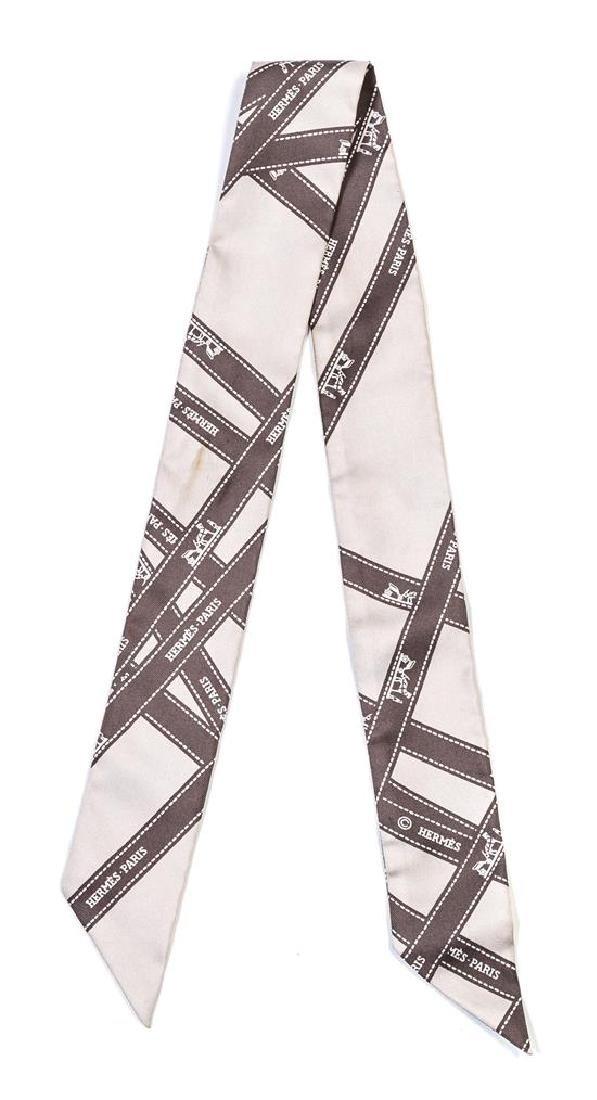 An Hermes Gray Silk Twilly Scarf,