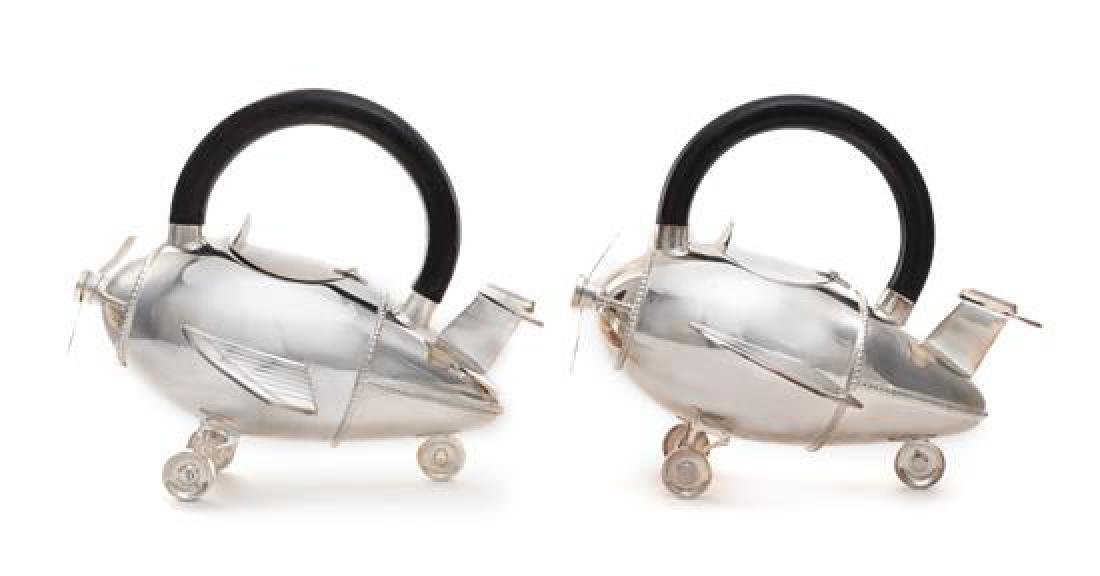 American, 20TH CENTURY, a pair of airplane form teapots