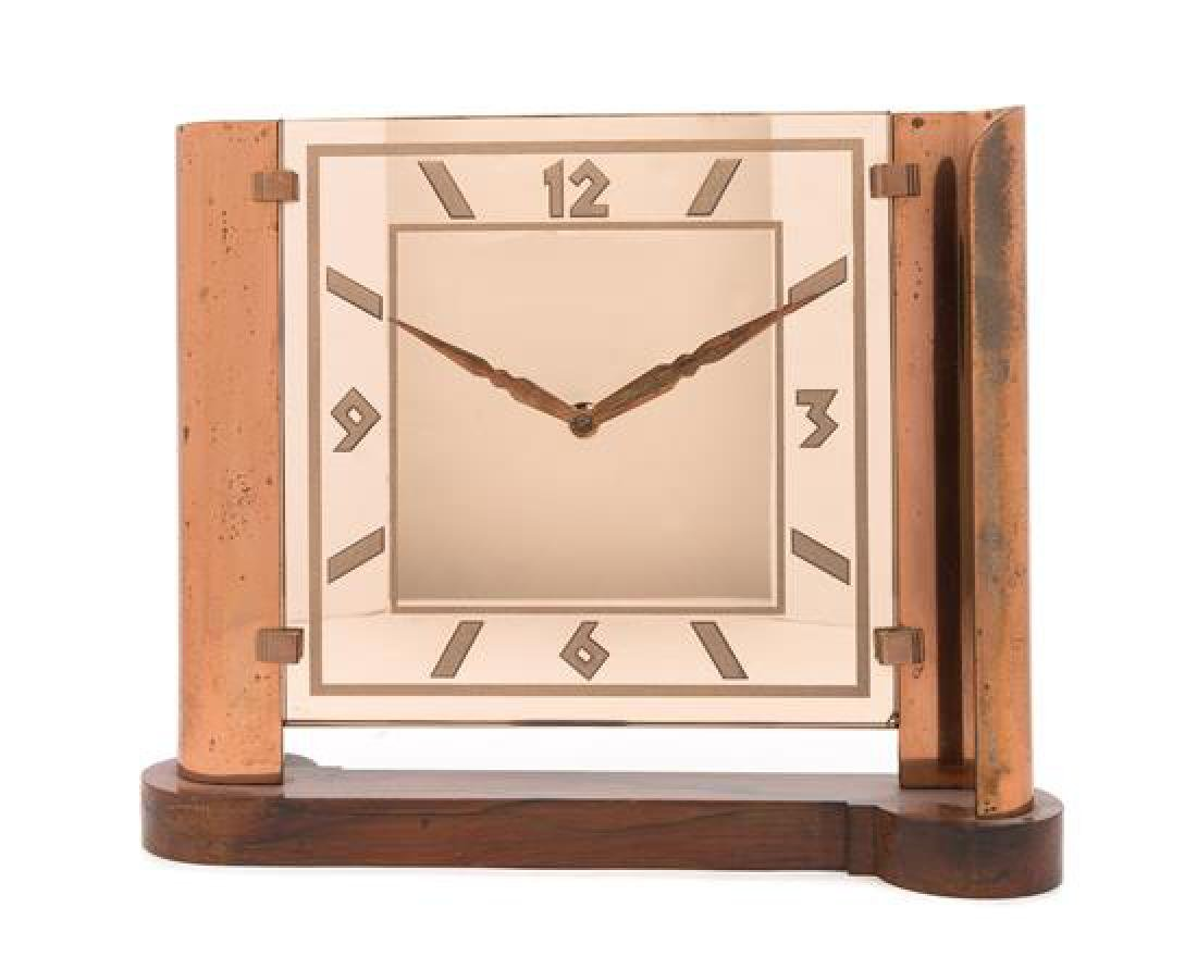 Art Deco, 1930s, a peach glass and copper clock, on a