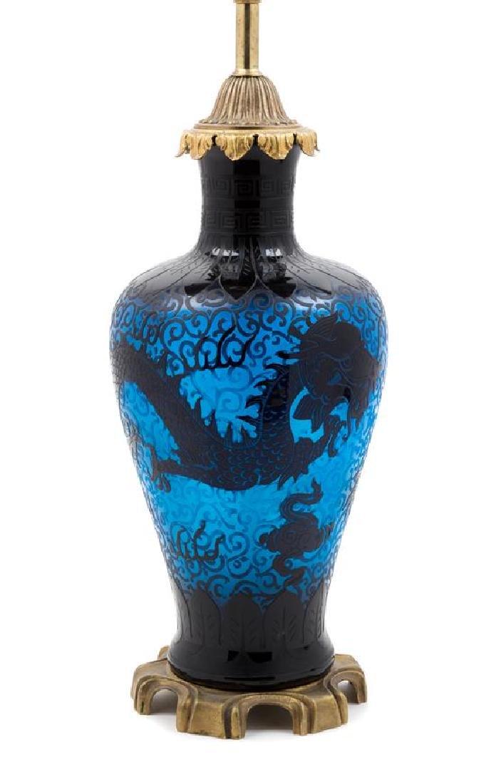 Steuben, 20TH CENTURY, a double etched dragon lamp,
