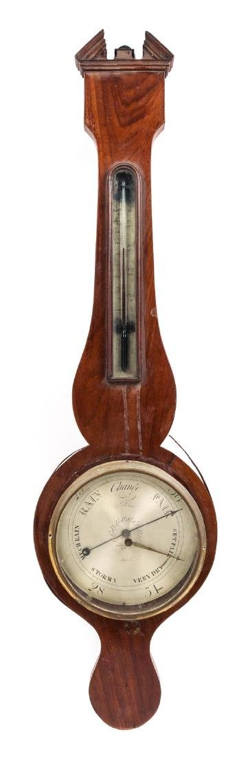 A Regency Mahogany Wheel Barometer Height 40 inches.