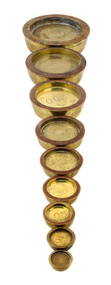 * A Set of Nine Brass Sovereign Weights Diameter of