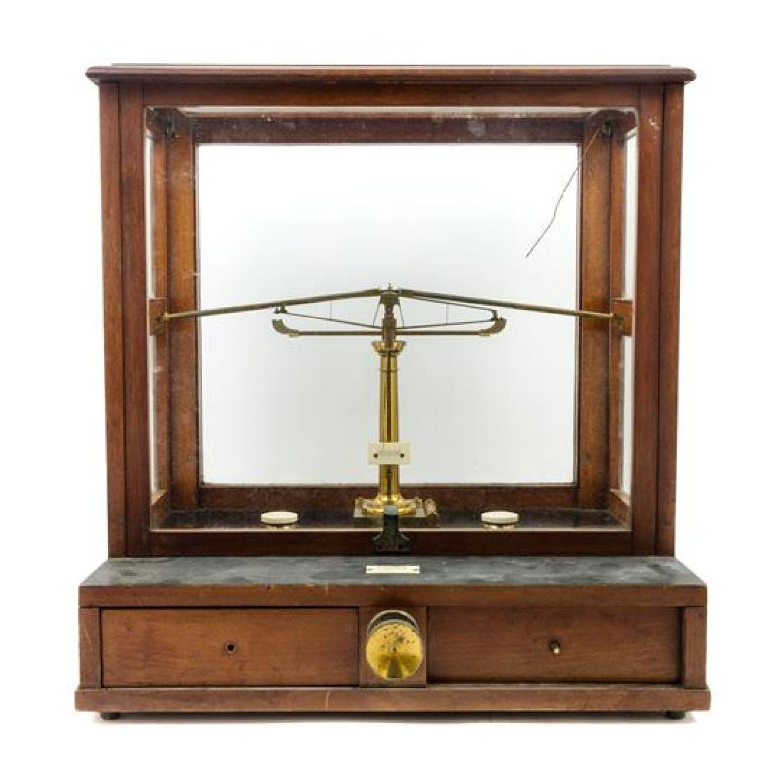 * An English Mahogany Cased Brass Assayer's Balance