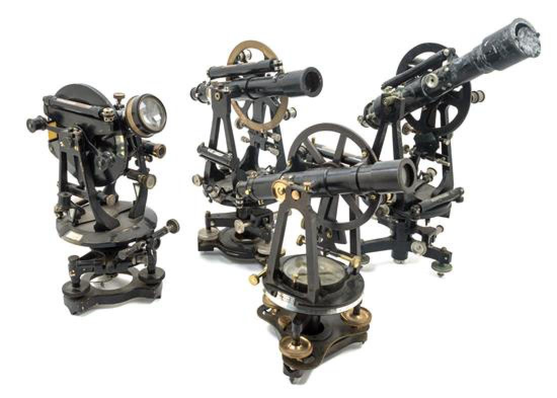 * A Group of Four Black Lacquered Theodolites Length of