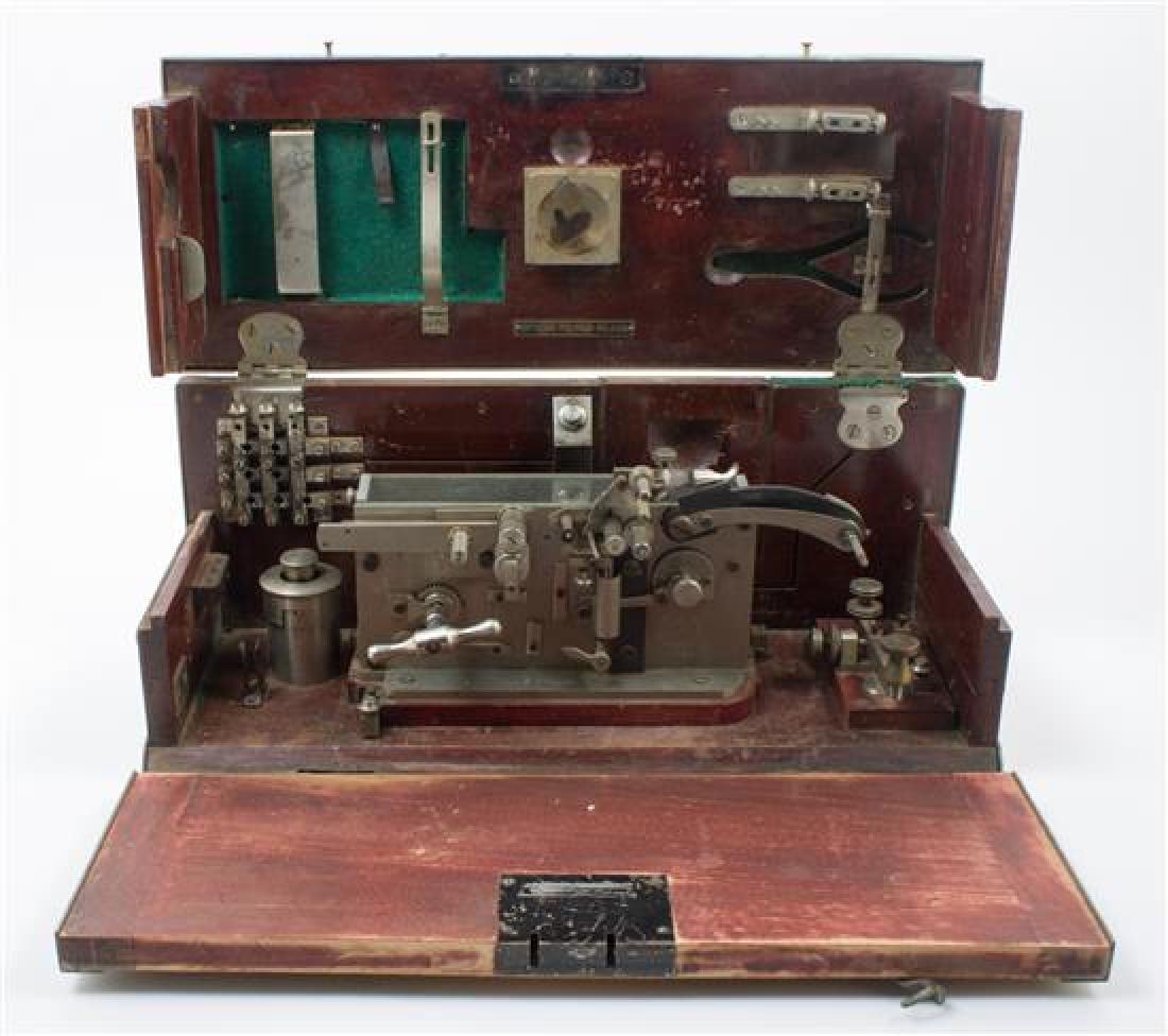 * An Italian Cased Field Telegraph Set Height of case 8