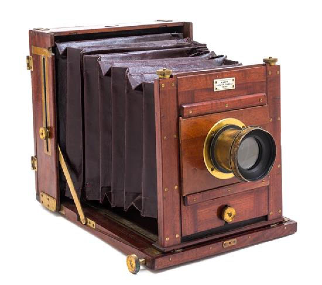 * An English Mahogany Cased Field Camera Case height 10