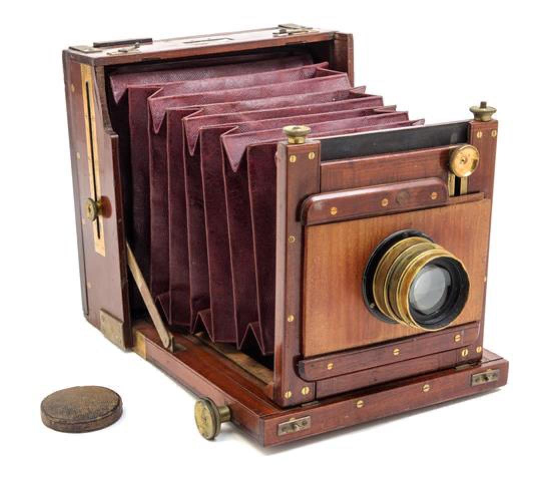 * A Scottish Mahogany Cased Field Camera Case height 8