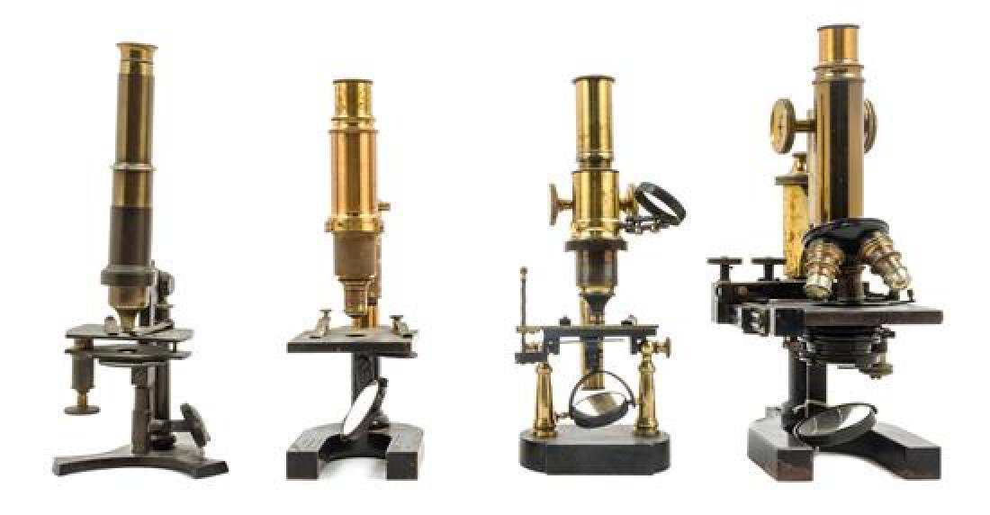 * A Group of Four Brass and Black Lacquered Microscopes