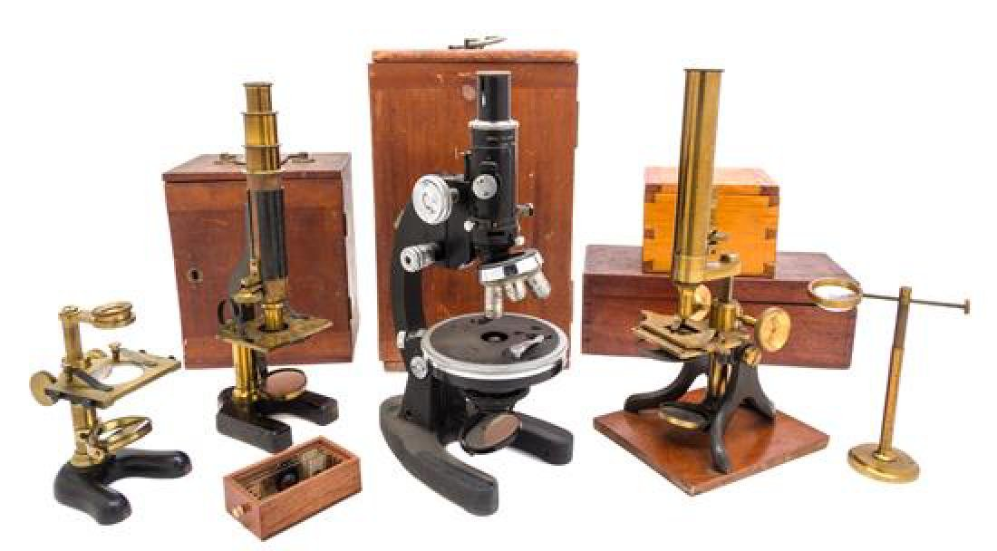 * A Group of Four Cased Microscopes Height of first 12