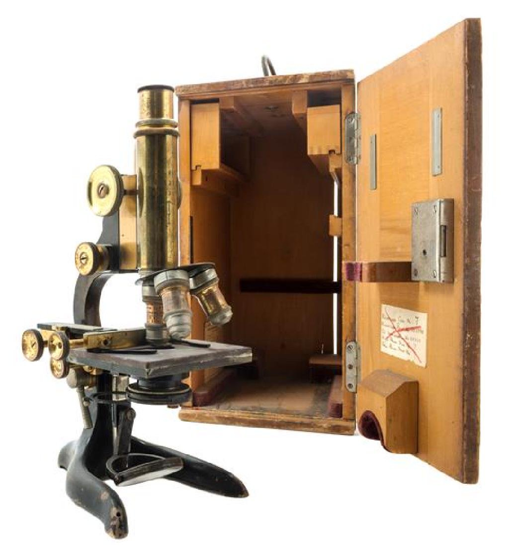 * A German Brass and Black Lacquered Microscope Height